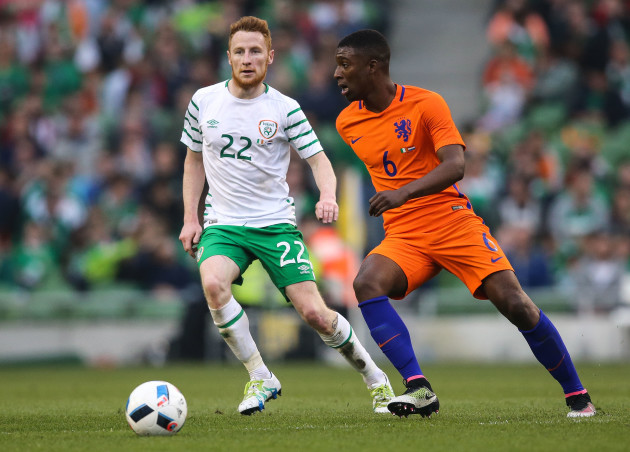 Stephen Quinn with Riechedly Bazoer