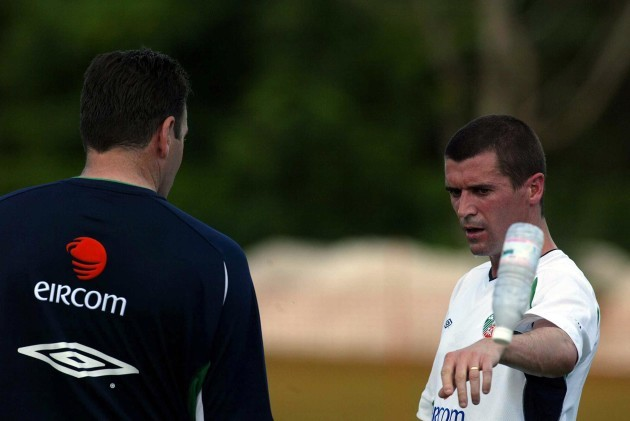 Roy Keane throws a bottle of water away
