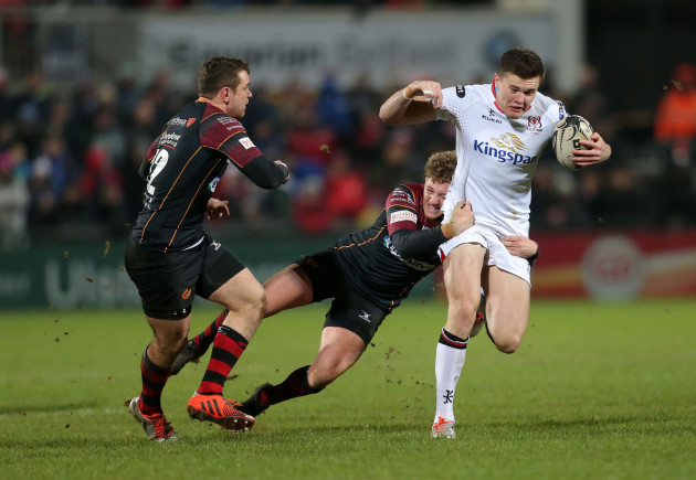 Jacob Stockdale is tackled by Angus OÕBrien