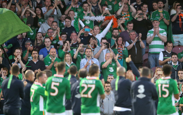 Republic of Ireland players applaud the supporters