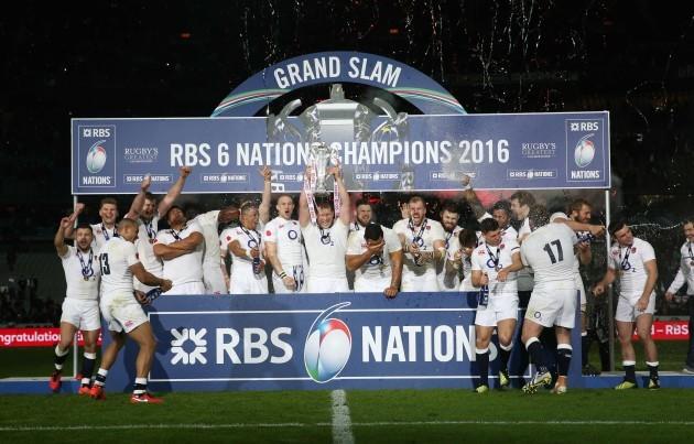The England team celebrate winning the Grand Slam