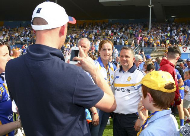 Davy Fitzgerald takes a picture with fans at the end of the game