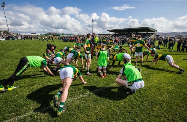 Kerry players warm down in front of their supporters