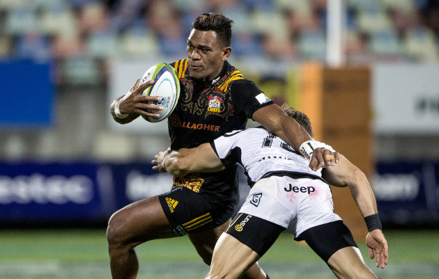 Seta Tamanivalu fends the tackle of Paul Jordaan