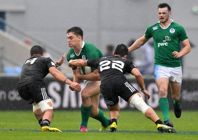 Conor O'Brien is tackled by TJ Va'a and Hamish Dalzell