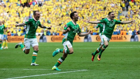 Wes Hoolahan celebrates scoring the first goal of the game with Glenn Whelan and Robbie Brady