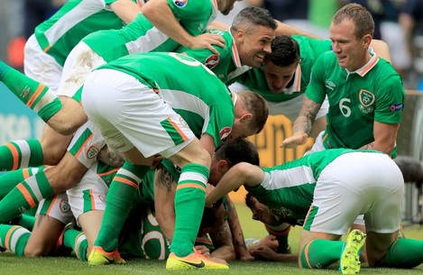 Wes Hoolahan celebrates scoring the first goal of the game with teammates