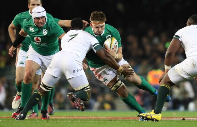 Iain Henderson is tackled by Siya Kolisi
