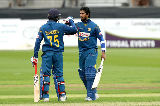 Dinesh Chandimal celebrates hitting a century with Dananjaya de Silva