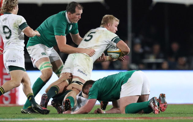 Springboks Pieter Steph du Toit  is tackled by Ireland's Devin Toner and Tadhg Furlong