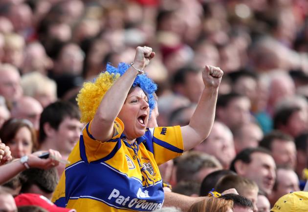 A Clare supporter celebrates a score