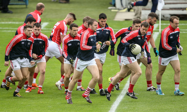 Colm O'Neill and the Cork team arrive out for the start of their warm up