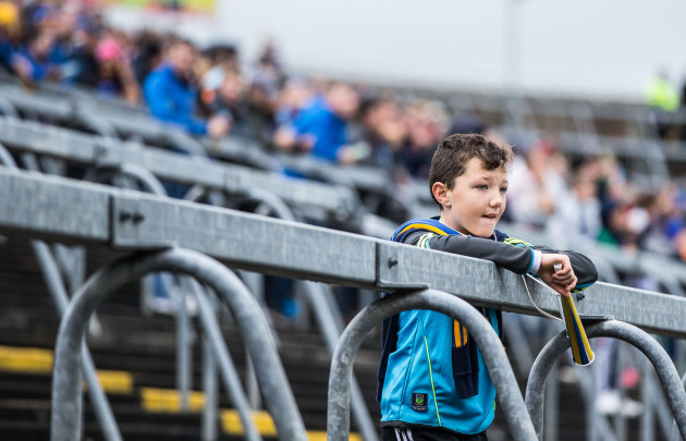 A young Tipperary supporter awaits the arrival of the teams