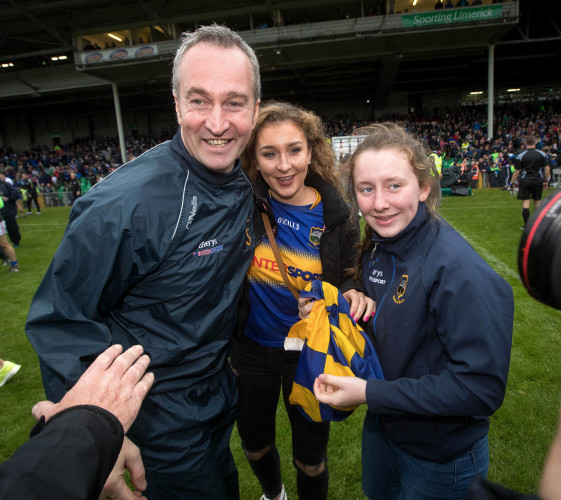 Michael Ryan celebrates with his daughters
