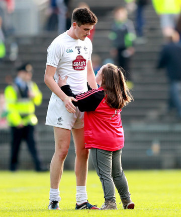 David Hyland consoled by a fan after the game