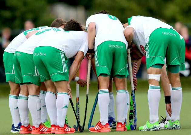 The Ireland team prepare to take a short corner