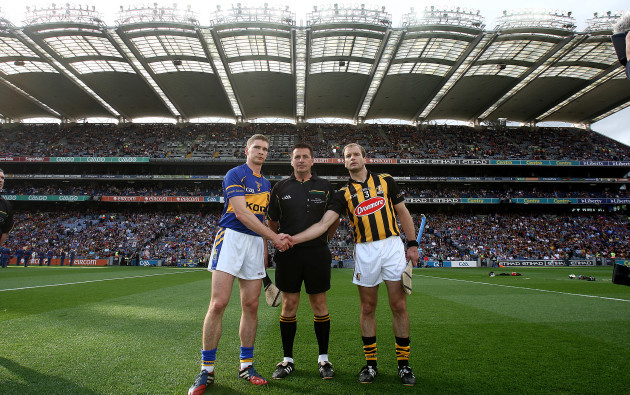 Brian Gavin with captains Brendan Maher and JJ Delaney