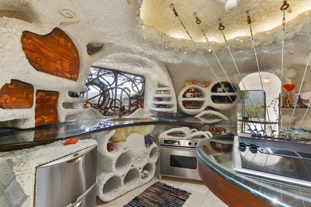 the-kitchen-features-a-center-island-attached-to-the-roof-of-the-house-which-also-features-a-skylight