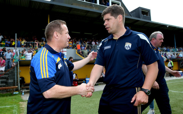 Colm Collins and Eamonn Fitzmaurice shake hands after the game