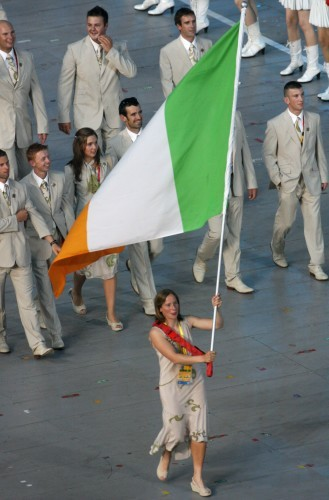 Ciara Peelo leads out the Irish team carrying the Tricolour