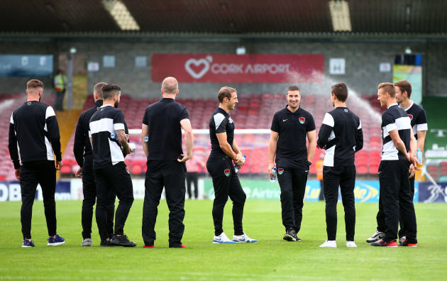 Cork City players check out the pitch
