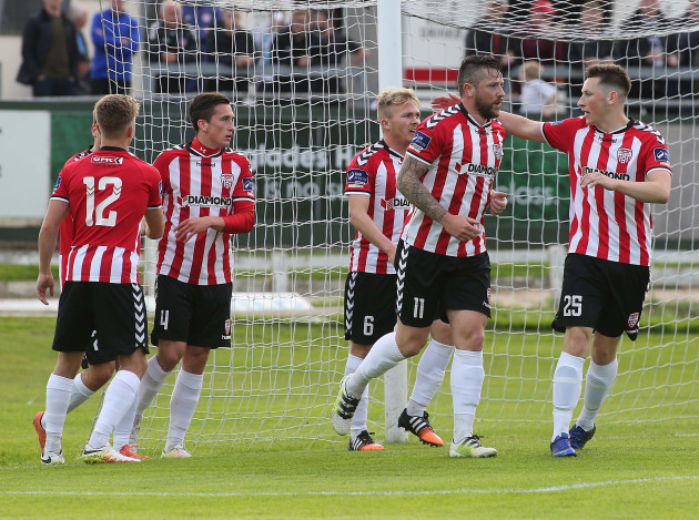 Rory Patterson celebrates scoring with teammates
