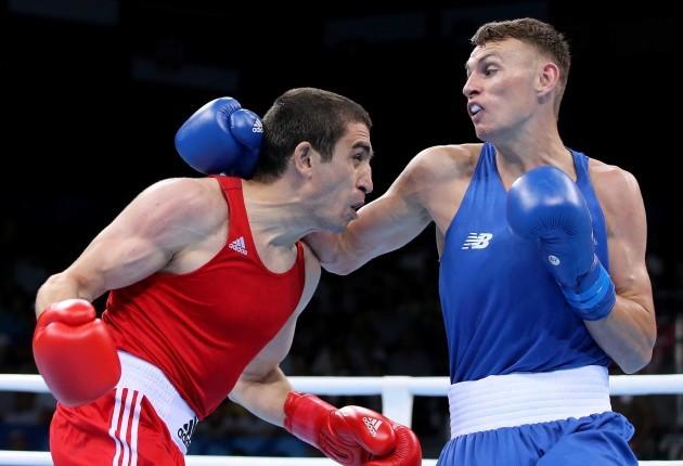 Sean McComb  in acton against Albert Selimov