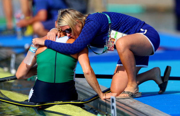 Sanita Puspure is consoled by Sarah Jane McDonnell after finishing fourth