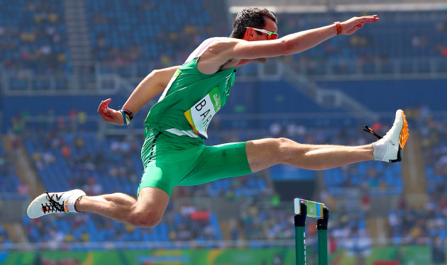 Thomas Barr clears the first hurdle during his heat
