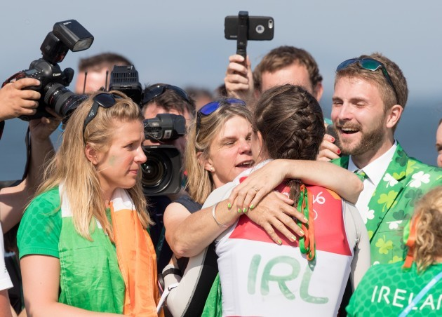 Annalise Murphy celebrates winning silver with brother Finn, mother Cathy McAleavey and sister Claudine
