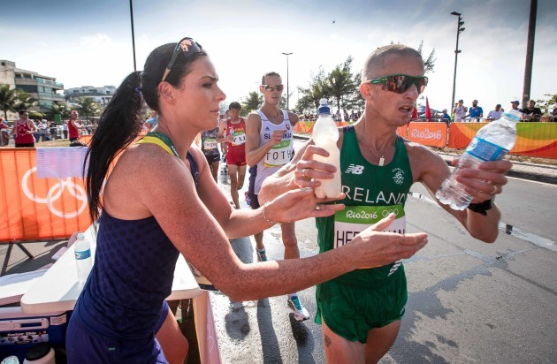 Ireland's Rob Heffernan receives water from his wife Marian