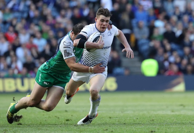 Leinster's Garry Ringrose is tackled by Connacht's Robbie Henshaw