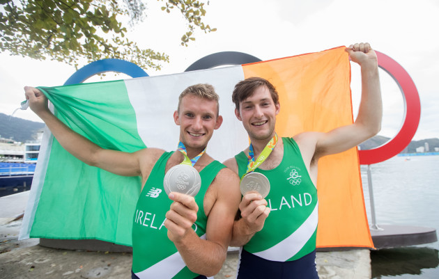 Paul and Gary O'Donovan celebrate winning a silver medal
