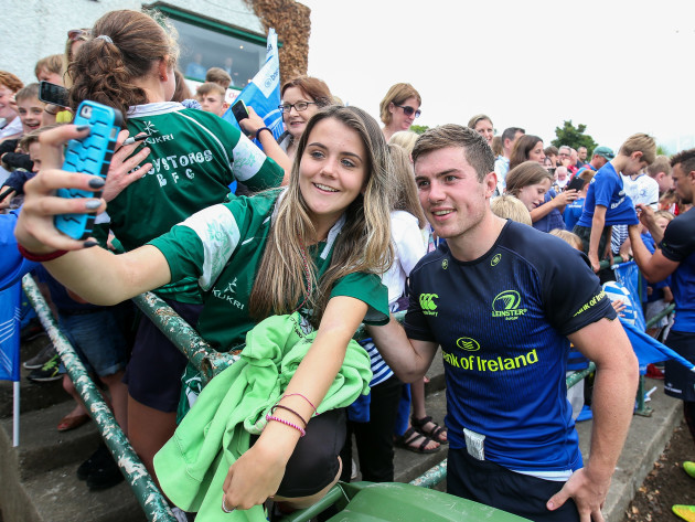Luke McGrath with a supporter