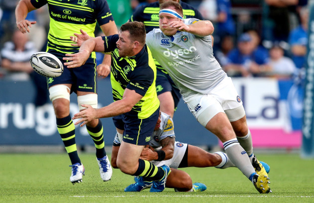 Cian Healy makes a pass despite being being tackled