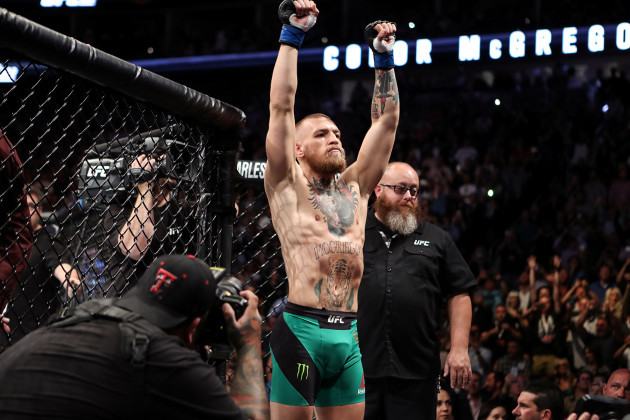 Conor McGregor enters the octagon