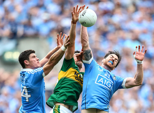 Diarmuid Connolly and Michael Darragh MacAuley with Anthony Maher