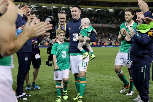 Robbie Keane with his sons Robert and Hudson are applauded off the pitch by team mates at the end of the game