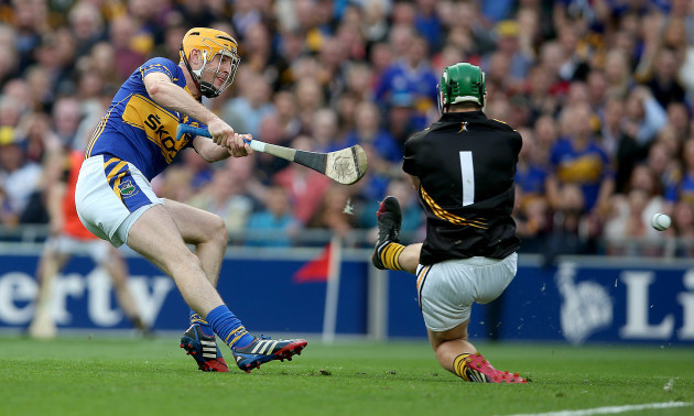 Seamus Callanan scores the first goal of the game passed Eoin Murphy
