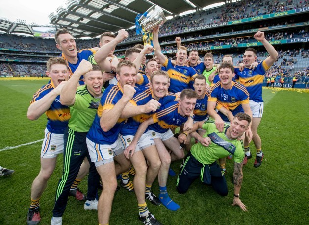Tipperary players celebrate with the Liam McCarthy Cup