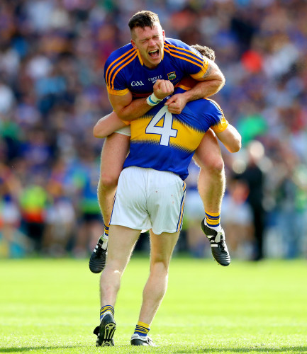 Padraic Maher and Michael Cahill celebrate at the final whistle