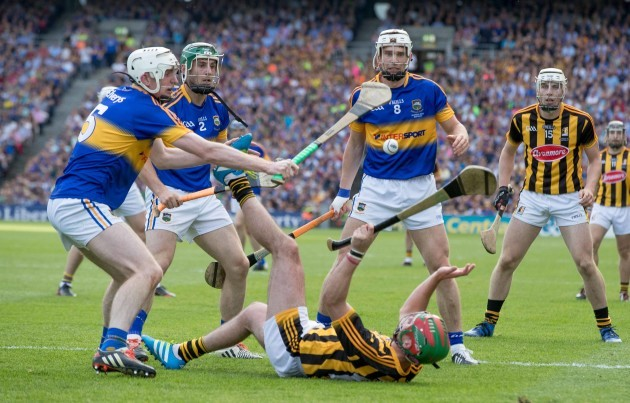 Eoin Larkin is surrounded by Seamus Kennedy, Cathal Barrett and Brendan Maher