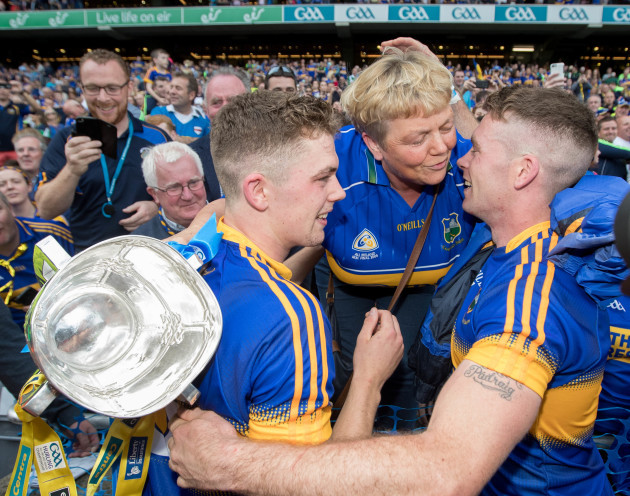 Padraic Maher and Ronan Maher celebrate with their mother Helen Maher
