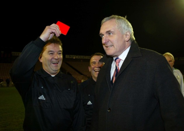 Pat Kelly issues a disgusted Bertie Ahern with a red card