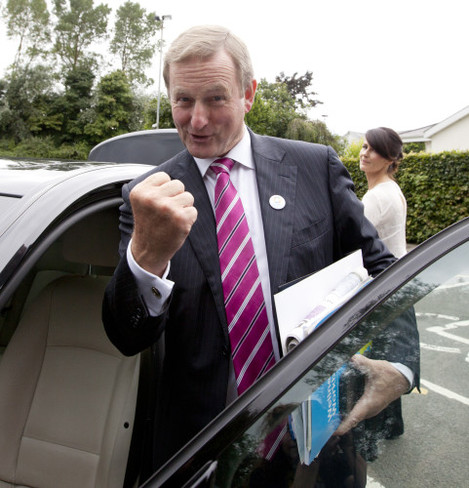 13/9/2016. . Day 2 Fine Gael Think-In 2016. A defiant Taoiseach Enda Kenny, displays his newfound Mojo, as he gets into his car at the end of his meeting with his Parliamentary Party, at the Keadeen Hotel in Newbridge, Co Kildare, where the annual Fine Ga