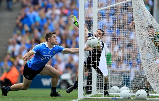 Stephen Cluxton and David Byrne fail to stop Paul Geaney scoring a goal