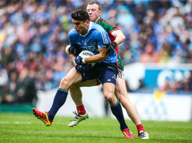 Bernard Brogan is tackled by Colm Boyle