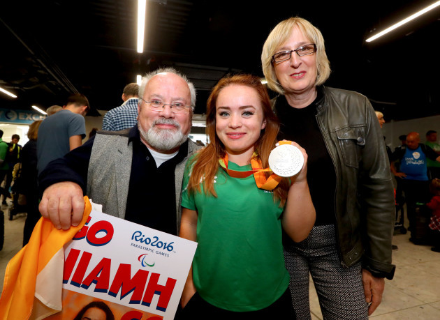 Niamh McCarthy with her parents Flor and Caroline McCarthy
