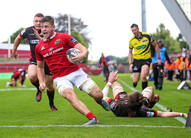 Conor Oliver runs to score a try