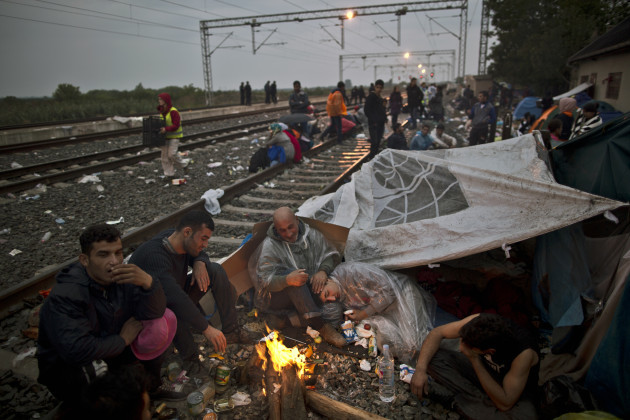 Exhausted Migrants Photo Gallery